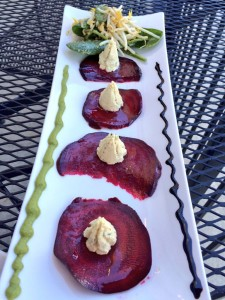 Beet carpaccio with cashew cheese and olive pesto